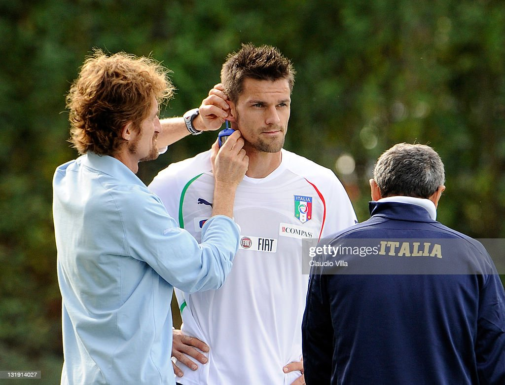 Doctor Luca Gatteschi and Christian Maggio of Italy during a training session at Coverciano on November 8, 2011 in Florence, Italy.