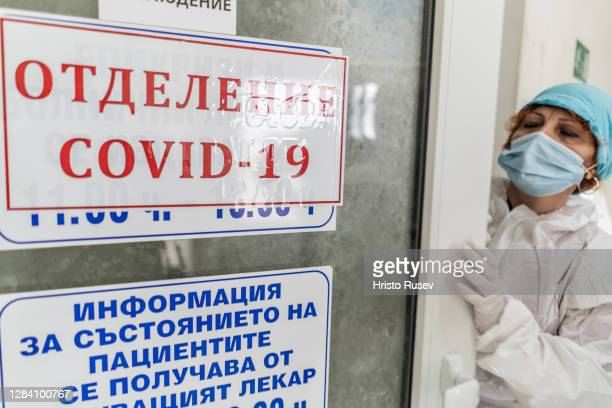 Doctor Mariyana Chatalova is seen wearing protective equipment before entering a coronavirus patients room in the ICU of Haskovo Hospital on November...