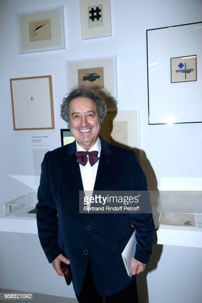 Doctor Mark Khidekel posing in front of the work of his father Lazar Khidekel attends the 'Chagall Lissitzky Malevitch L'Avantgarde Russe a Vitebsk...