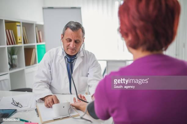 Doctor measuring blood preassure