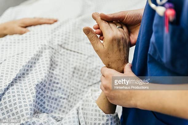 Doctor Measuring Puls Of Patient