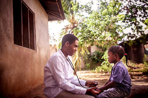 Doctor meet African child 1129582306