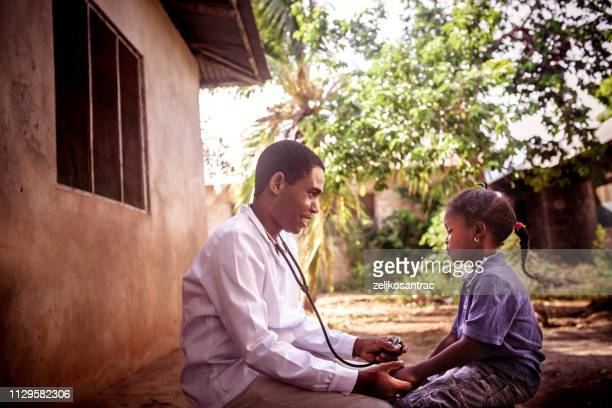 doctor meet african child - africa stock pictures, royalty-free photos & images
