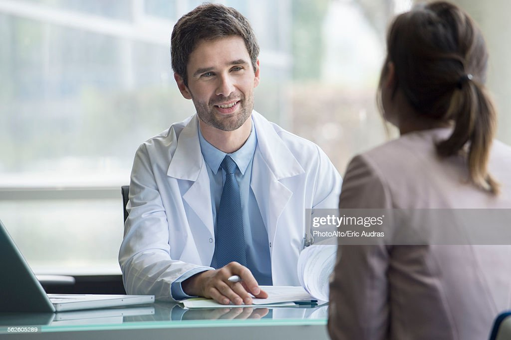 Doctor meeting with patient : Stock Photo