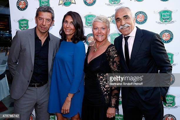 Doctor Michel Cymes and his wife Nathalie, Mansour Bahrami and wife Frederique attend the Trophee des Legendes Dinner at Le Fouquet's, champs Elysees...
