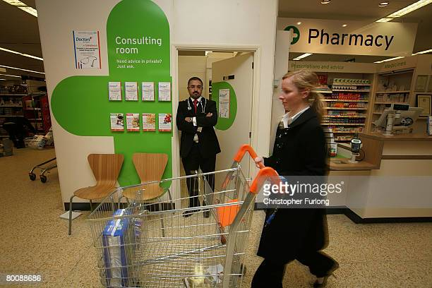 Doctor Mohammed Jiva poses as he prepares to see patients in England's first GP surgery inside a Sainsbury's supermarket on March 3 2008 in...