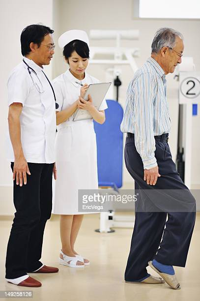 Doctor Observing Senior Pateint in Hospital