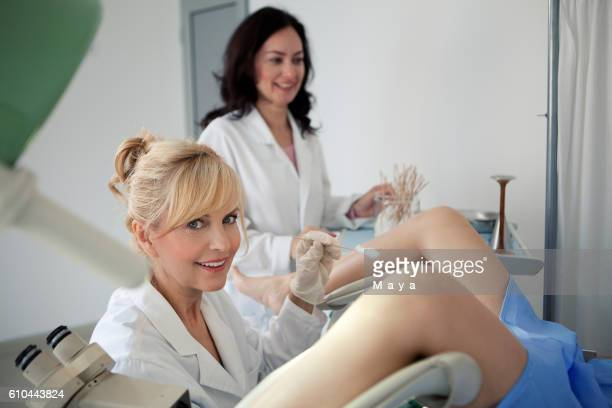 doctor obtaining a cervical smear - pelvic exam stock photos and pictures