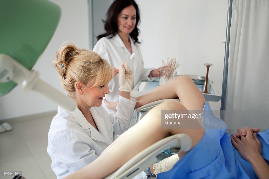 Doctor obtaining a cervical smear : Stock Photo