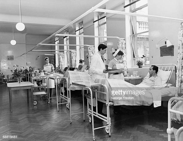 Doctor on his morning rounds in the men's surgical ward at St. Bartholomew's Hospital, London, February 1968.