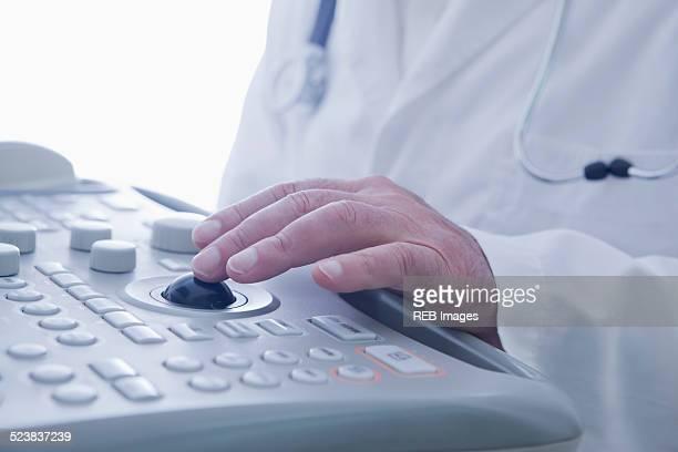 Doctor operating ultrasound scanner