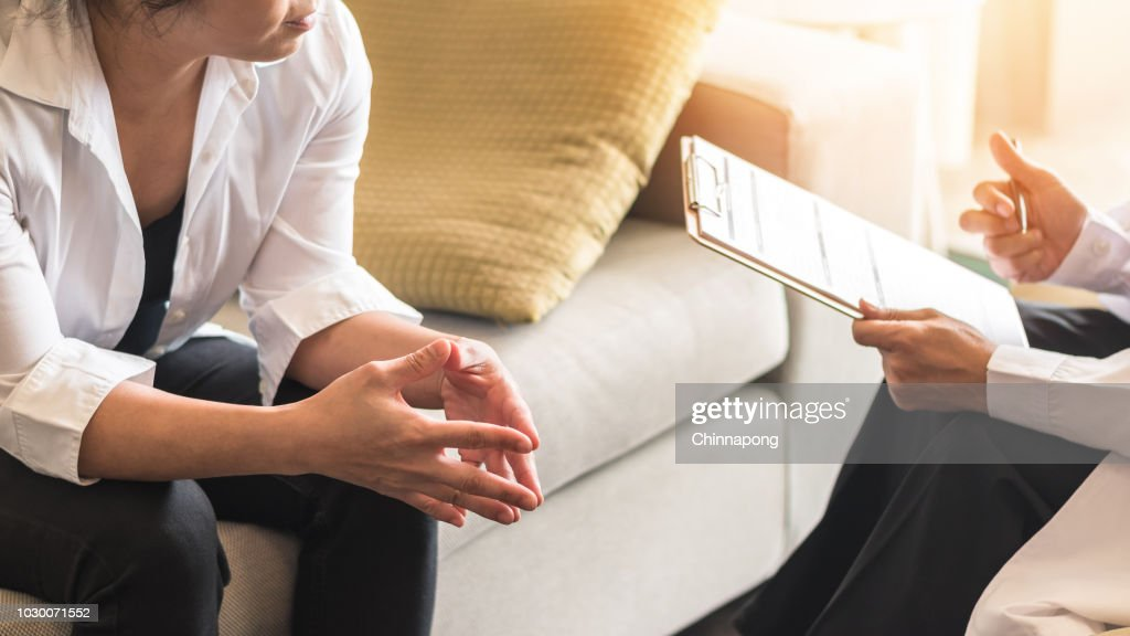 Doctor or psychiatrist consulting and diagnostic examining stressful woman patient on obstetric - gynecological female illness, or mental health in medical clinic or hospital healthcare service center : Stock Photo