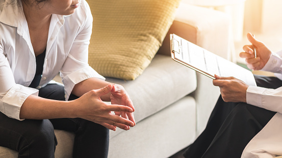 Doctor or psychiatrist consulting and diagnostic examining stressful woman patient on obstetric - gynecological female illness, or mental health in medical clinic or hospital healthcare service center 1030071552