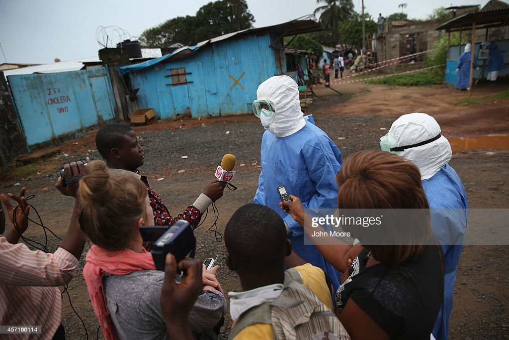 A doctor outside the JFK Ebola treatment center speaks to journalists on October 13, 2014 in Monrovia, Liberia. A planned strike was averted as most nurses and health care workers reported for work, many saying they could not in good conscience leave their patients unattended. Health workers have been asking for increased hazard pay. They are one of the most high-risk groups of Ebola infection, as nearly 100 of them have died in Liberia alone.