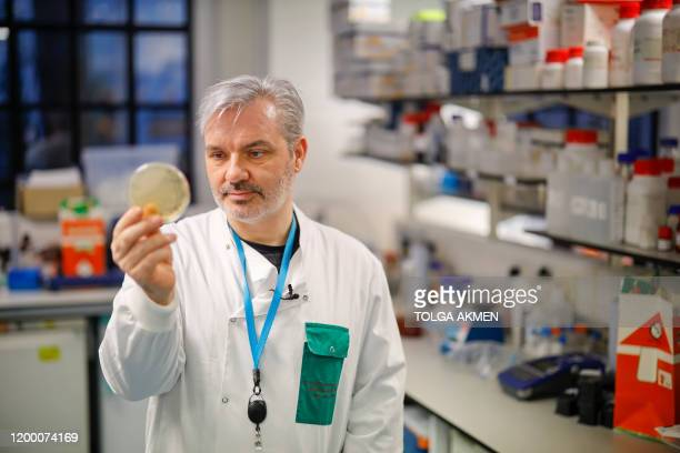 Doctor Paul McKay, who is working on an vaccine for the 2019-nCoV strain of the novel coronavirus, Covid-19,, poses for a photograph with bacteria...