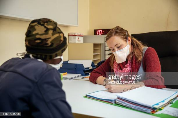 Doctor Pauline Howell speaks with a patient known as Nxumalo currently on the NIX treatment at the Sizwe Tropical Diseases Hospital in Johannesburg...