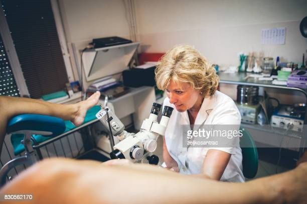 doctor performing ultrasound on a pregnant woman - pelvic exam stock photos and pictures