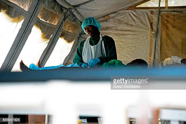 A doctor performs circumcision on a young South Sudanese refugee boy at the Ocea health centre on July 31 2017 at Rhino settlement camp a refugee...