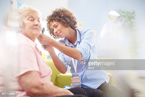 ent  doctor - ear exam stock photos and pictures