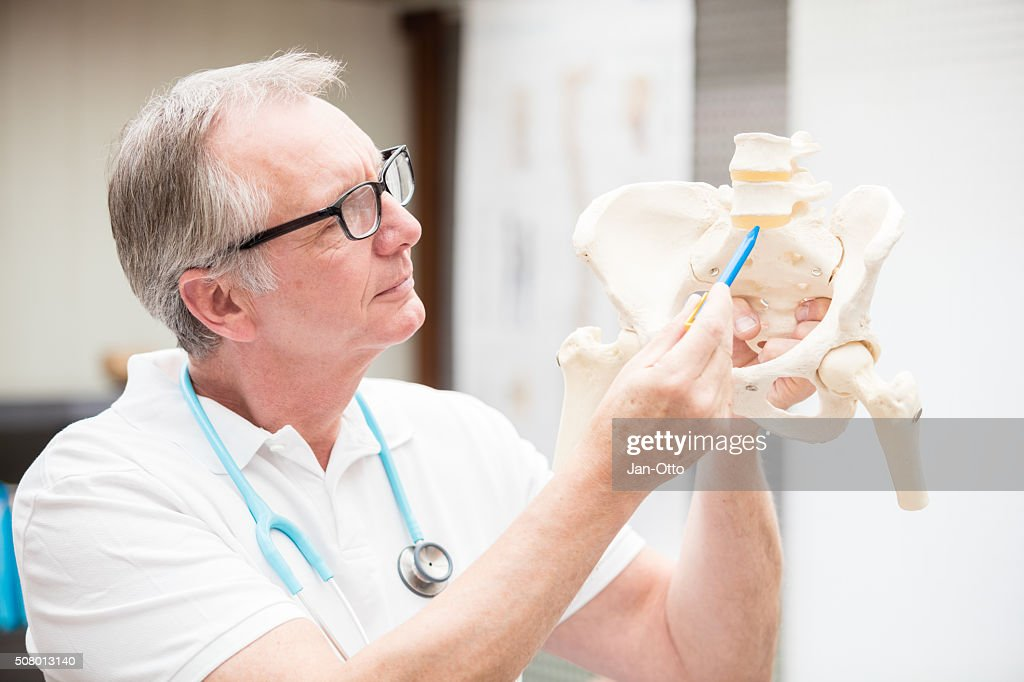 Doctor pointing at discus : Stock Photo