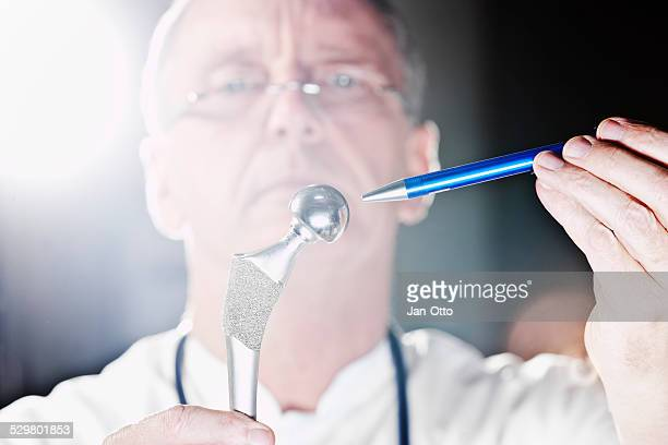 Doctor pointing at total hip endoprothesis