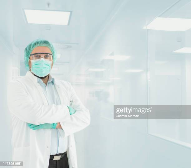 doctor portrait in hospital lab - face mask protective workwear stock pictures, royalty-free photos & images