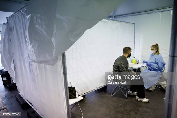Doctor prepares to administer a dose of the Moderna vaccine in a temporary vaccination center, where a voucher for a doner kebab is issued after the...
