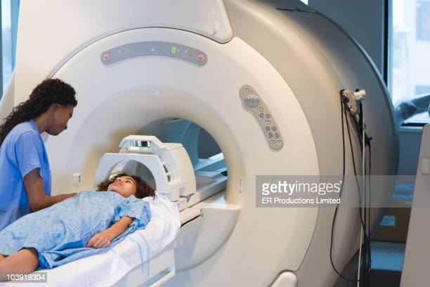 Doctor preparing patient for MRI