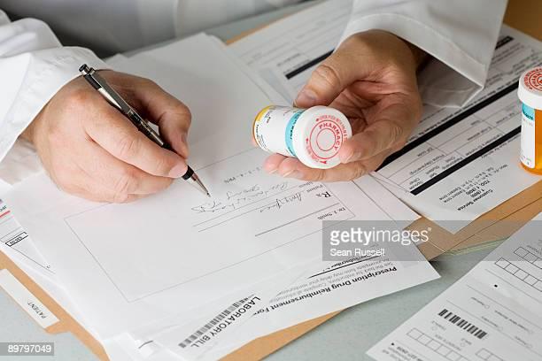 A doctor prescribing medicine
