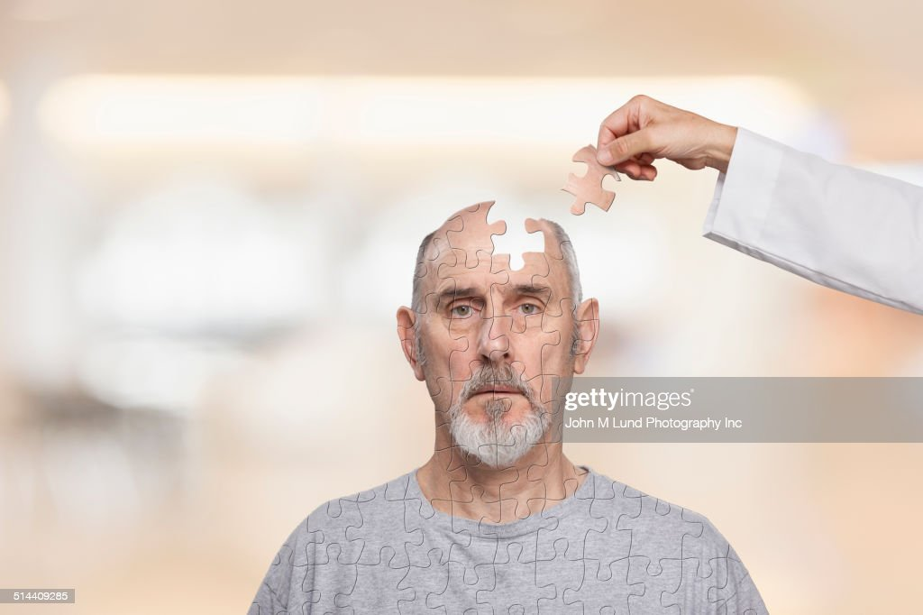 Doctor putting human puzzle together : Stock Photo