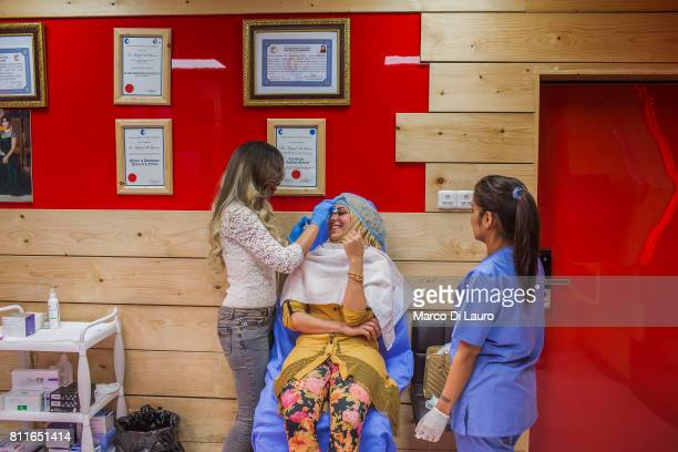 """April 20: Doctor Rafeef al-Yazerie is seen as she treats a patient at the Barbie Clinic on April 20, 2015 in Baghdad, Iraq. """"nThe Barbie Clinic was..."""