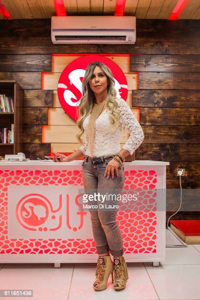 """April 20: Doctor Rafeef al-Yazerie is seen in her studio at the Barbie Clinic on April 20, 2015 in Baghdad, Iraq. """"nThe Barbie Clinic was open in..."""