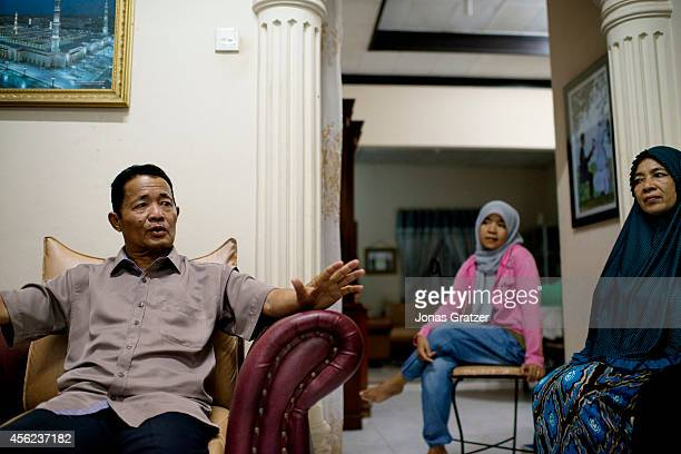 Doctor Raffiuddin the Chief in Justice of the region's Sharia court sits in his home to explain in further detail about the Sharia Law In the...