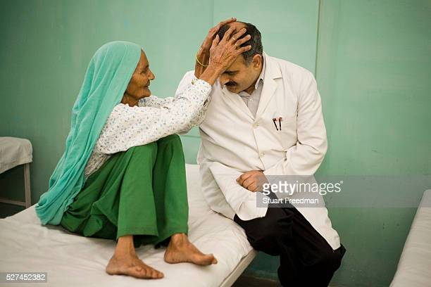 Doctor Rajendra Trishal is blessed by a patient whose cataracts the doctor removed the previous day Ginni Modi Opthalmic Research Centre Modinagar...