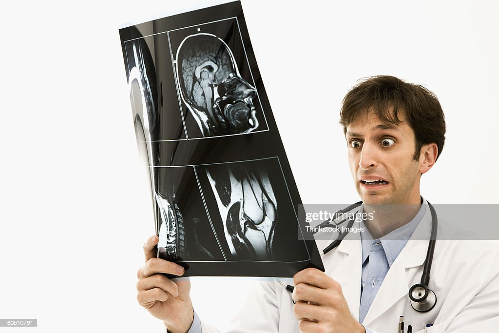 Doctor reacting to X-ray : Stock Photo