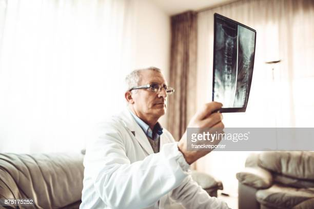 doctor reading his xrays at home