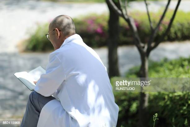 Doctor reading medical book