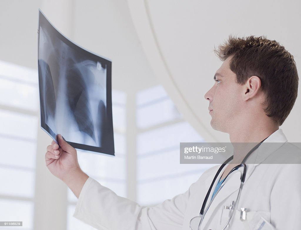Doctor reviewing x-ray : Stock Photo