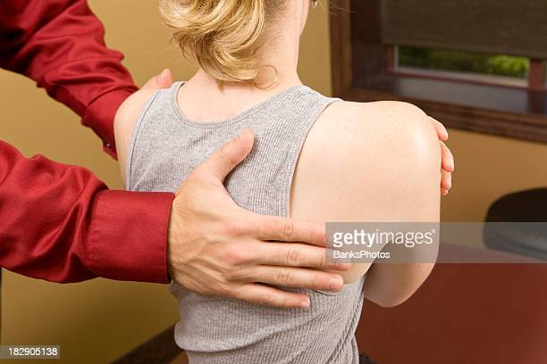 Doctor Rotating Female's Shoulders