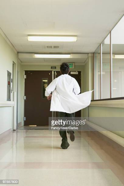 Doctor running down hallway