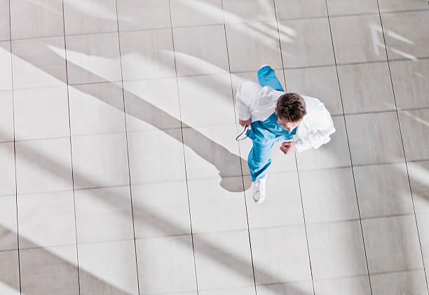 Doctor running through hospital lobby