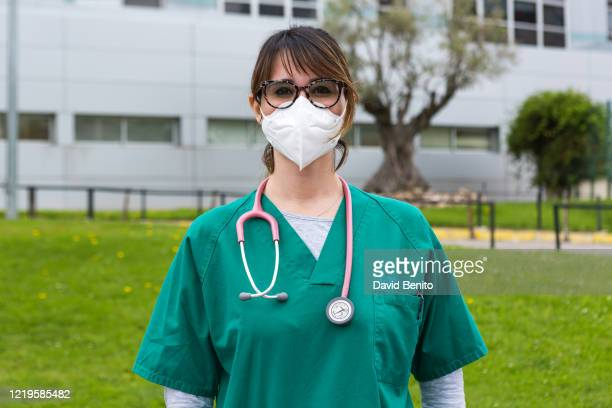 Doctor Sara Muñoz Medina poses wearing a face mask at Ramón y Cajal Hospital on April 18, 2020 in Madrid, Spain. Spain is beginning to reduce strict...