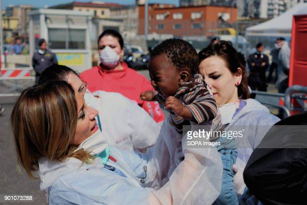 A doctor seen saving a child from a respiratory crisis during landing operations from Vos Prudence a rescue boat of Msf On May 28th 2017 'Vos...
