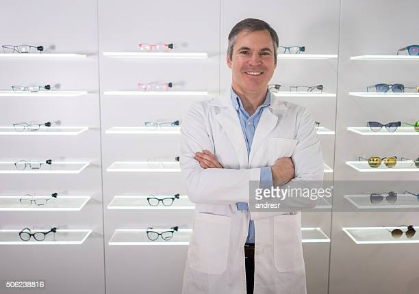 Doctor selling glasses at an optics