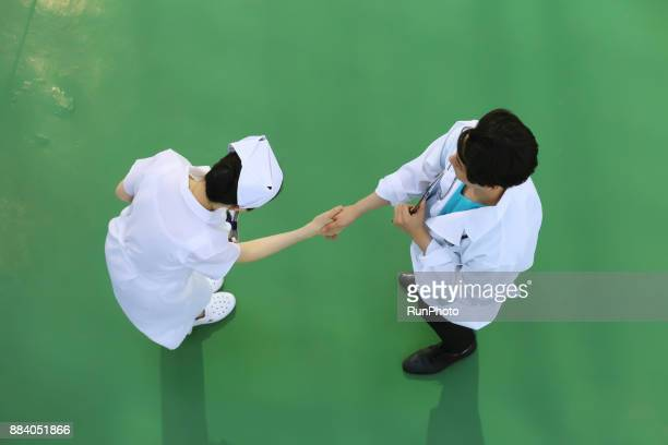 Doctor shaking hands with nurse