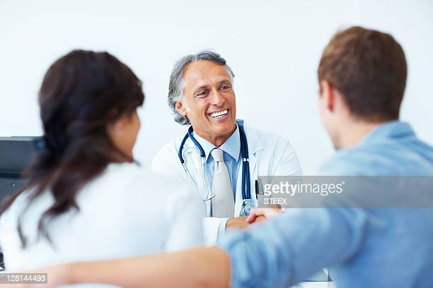 Doctor shaking hands with the patients