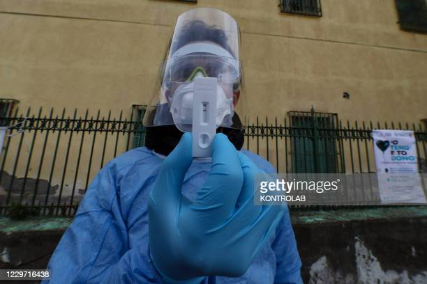 "Doctor shows a negative test during the first day of the ""solidarity swab"" project, an initiative promoted by the Community Foundation ""Maria Family""..."