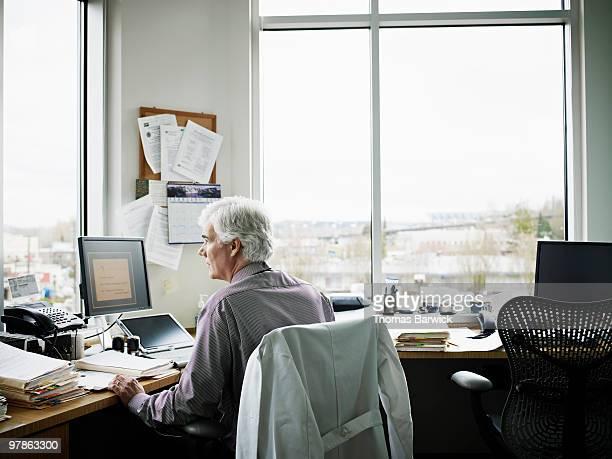 Doctor sitting at desk in medical office