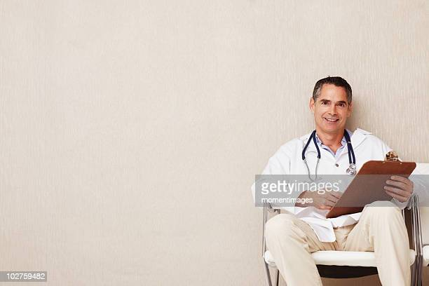 Doctor sitting in waiting room