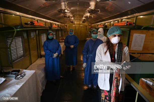Doctor speaks with her colleagus wearing protective gear in a train coach prepared as a temporary quarantine facility at the Rawalpindi Railway...